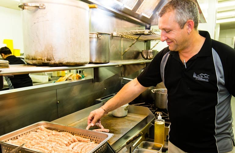 Frying up some Pork Sausages | Off The Track | Havelock North | Family Friendly Restaurant